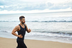 Running Man Jogging At Beach During Fitness Workout Outdoor. Spo Stock Photography