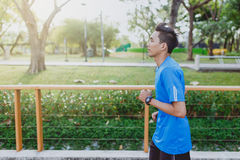 Running man. Male runner jogging during outdoor workout at public park.  Royalty Free Stock Photos