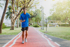 Running man. Male runner jogging during outdoor workout at public park.  Royalty Free Stock Photography