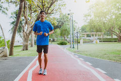 Running man. Male runner jogging during outdoor workout at public park.  Royalty Free Stock Images