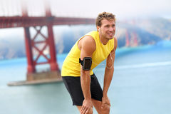 Running man - male runner resting in San Francisco Royalty Free Stock Images
