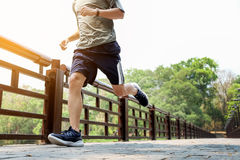 Running man. Male runner at sprinting speed training for maratho. N outdoors Stock Photos