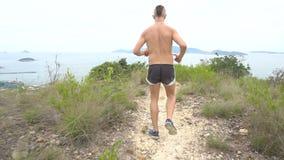 Running man on mountain road. stock video