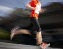 Running man in orange Royalty Free Stock Photos