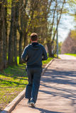 Running man in the park view from  back Royalty Free Stock Image