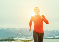 Running  man portrait in cold spring day Royalty Free Stock Image