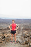 Running man - portrait of male runner resting. After cross country run on trail. Fit handsome athlete taking break standing in amazing volcano landscape on Big Stock Images