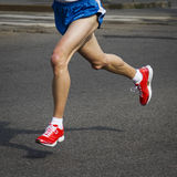 Running man with red shoes Royalty Free Stock Photography