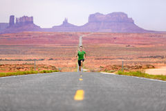 Running man - runner on road by Monument Valley Royalty Free Stock Photos