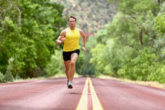 Running man runner sprinting for fitness health. Running man runner sprinting for fitness and health. Male athlete in sprint run wearing sports running shoes and Royalty Free Stock Photography