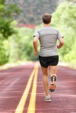 Running man runner working out for fitness jogging. Running man runner working out for fitness. Male athlete on jogging run wearing sports running shoes and royalty free stock photography