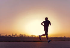 Running man silhouette in sunset time Royalty Free Stock Photos