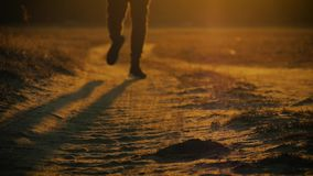 Running man silhouette in sunset time. Outdoor cross-country running. Athletic young man is running in the nature during. Golden sunset. Healthy lifestyle stock footage