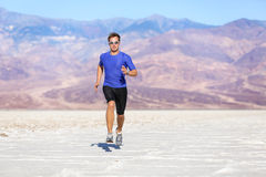 Running man - sprinting athlete runner in desert Royalty Free Stock Photo