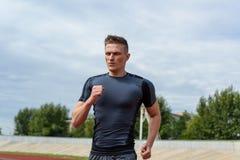 Running man on the stadium Royalty Free Stock Images