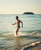 Running man in water of sea Royalty Free Stock Photography