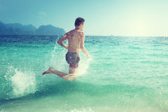 Running man in water of sea Royalty Free Stock Images