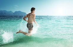 Running man in water Stock Photo