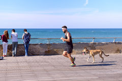 Free Running Man With The Dog Royalty Free Stock Photography - 66605407