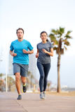 Running man and woman, Barcelona Beach Barceloneta Royalty Free Stock Photo