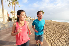 Running man and woman, Barcelona Beach Barceloneta Royalty Free Stock Images