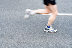 Running marathon on city street, motion blur Stock Image