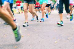 Running Marathon - Close up of legs running royalty free stock photography