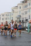 Running marathon exercise sport healthy. Leading runners run along closed roads at Brighton half marathon in Sussex, England Royalty Free Stock Images