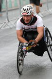 Running marathon exercise sport healthy parathlete. A disabled para athlete in a special racing wheelchair takes part in the Brighton half marathon in Sussex Royalty Free Stock Image