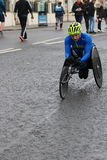 Running marathon exercise sport healthy parathlete. A para athlete in his special racing bike at Brighton half marathon in Sussex, England Royalty Free Stock Image