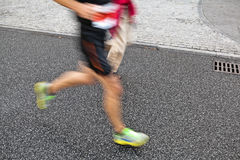 Running marathon motion blur Stock Images