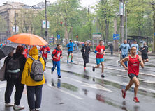 Running marathon race in the rain Royalty Free Stock Photography