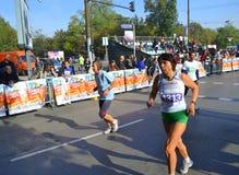 Running marathon women competitors Stock Photo