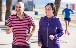 Running mature couple Stock Photo