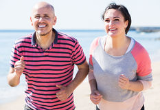 Running mature couple royalty free stock photos