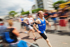 Running men at Bonn Triathlon Stock Photo