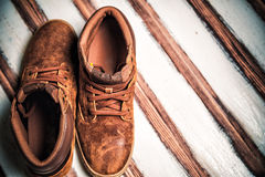 Running men on vintage wooden background Stock Images