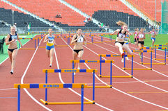 Running the 400 meter hurdles. Girls Stock Photos