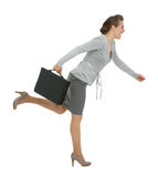 Running modern business woman with briefcase Royalty Free Stock Photos