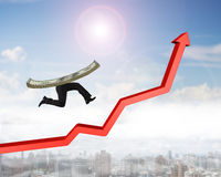 Running money with human legs on red arrow up graph Royalty Free Stock Image