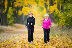 Running. Mother and daughter running around in the park Royalty Free Stock Photo