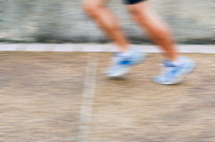 Running in motion blur Stock Photos