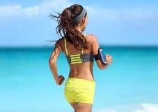 Running motivation - runner training with music Stock Photo