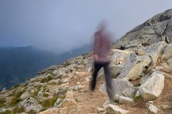Running in the mountains Stock Photo