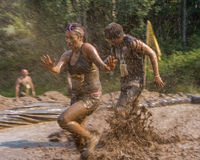 Running through the mud mines. BOISE, IDAHO/USA - AUGUST 10: Unidentifed runners trying to beat the mines at the The Dirty Dash in Boise, Idaho on August 10 Stock Images
