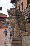 Running Nepalese boy at Durbar Squar, Bhaktapur Royalty Free Stock Images