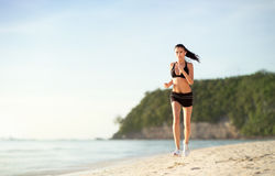 Running by the ocean Stock Images