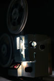 Running Old film projector. In dark room Royalty Free Stock Images