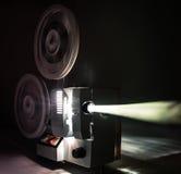 Running Old film projector. In dark room Stock Images