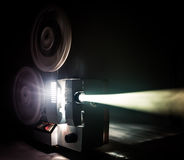 Running Old film projector. In dark room Royalty Free Stock Photo